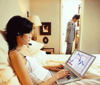 femme trader dans un lit